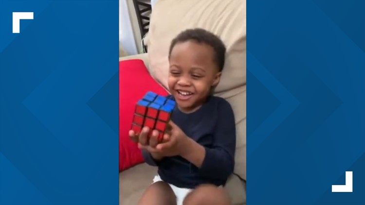 Image result for Boy genius! Watch as a 3-year-old Cleveland boy solves Rubik's Cube