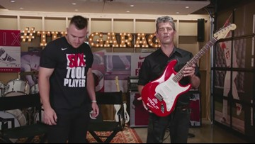 Rock Hall CEO Greg Harris gifts special guitar to Angels OF Mike Trout