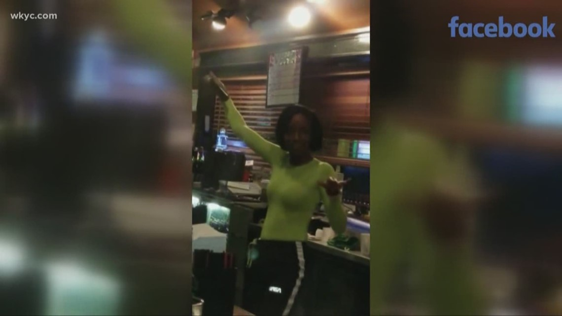 Cleveland woman goes viral after video posted of her singing and ringing up customers at bar