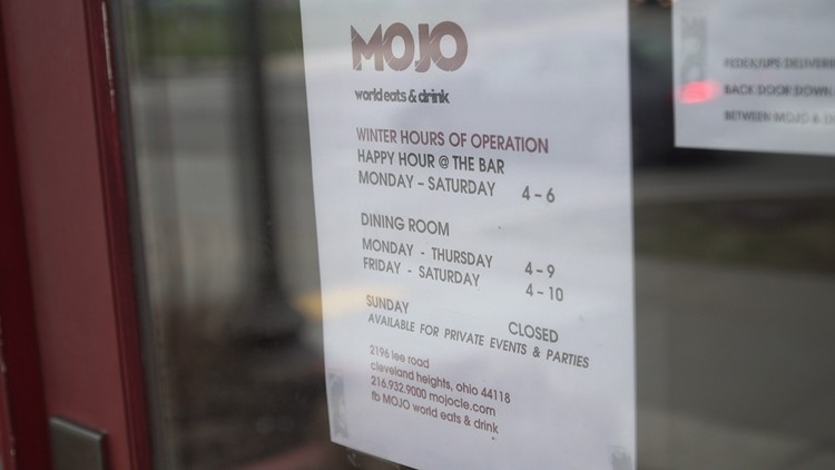 The sign outside the new Mojo World Eats and Drink