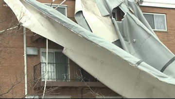 Wind damages apartment complex roof in Woodmere
