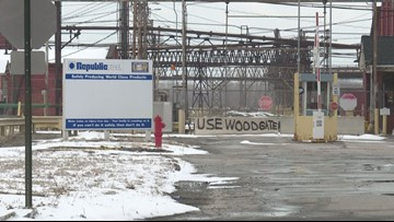 Crews cleaning up oil spill in Black River at Republic Steel plant in Lorain