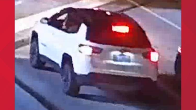 Officer struck suspect car