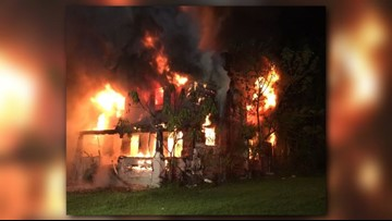 Officials investigating Akron house fire