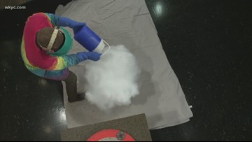 Mike Polk Jr. learns to make a cloud with the Great Lakes Science Center