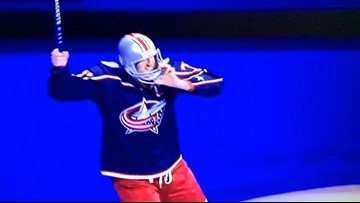 Watch: Columbus Blue Jackets captain Nick Foligno wears Ohio State helmet during postgame celebration