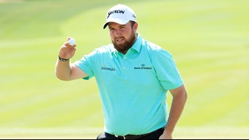 Shane Lowry resists Richard Sterne's challenge in Abu Dhabi for one-shot win