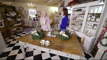Monica Potter teaches Betsy Kling how to make wreaths at her home store