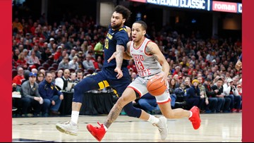 No. 22 West Virginia rallies, upsets No. 2 Ohio State 67-59 in Cleveland