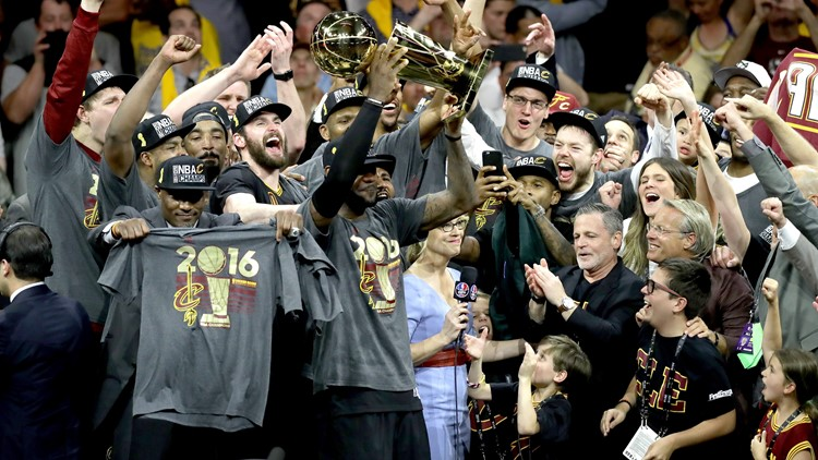 LeBron James hoists NBA Championship Trophy