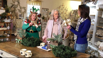 Actress Monica Potter teaches Betsy Kling how to make wreaths at her home store in Garrettsville