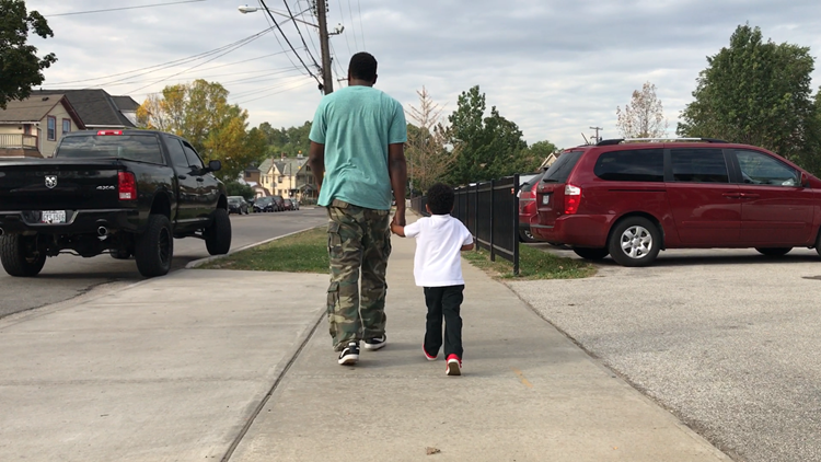 Dads show up, hand in hand with their kids, for Northeast Ohio's annual Fathers Walk