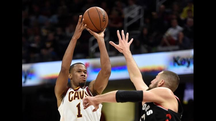 Cleveland Cavaliers guard Rodney Hood (1) shoots against Toronto Raptors center Jonas Valanciunas (17) in the third quarter at Quicken Loans Arena.