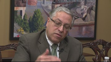 Armond Budish speaks to Tom Meyer after authorities search his office