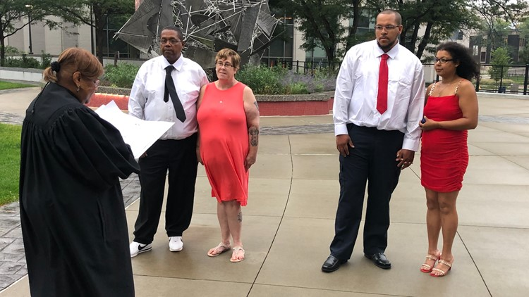 Akron Municipal Court offers outdoor weddings at Cascade Plaza, including double ceremony with father and son marrying sweethearts at same time