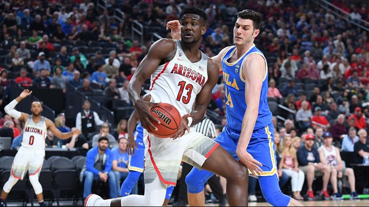 Arizona Wildcats forward Deandre Ayton (13) spins off UCLA Bruins forward Gyorgy Goloman (14) during a semi-final match of the Pac-12 Tournament at T-Mobile Arena in Las Vegas, Nevada.