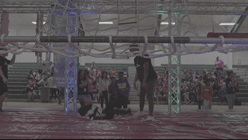 Akron's I PROMISE students take on American Ninja Warrior course