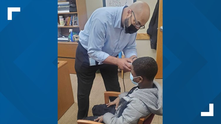 A cut above: Principal-turned-barber forms bond with student who was ashamed of his haircut