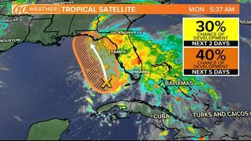 National Hurricane Center keeps an eye on a Gulf system