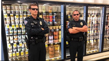 Officers stand guard over ice cream following Blue Bell licking video