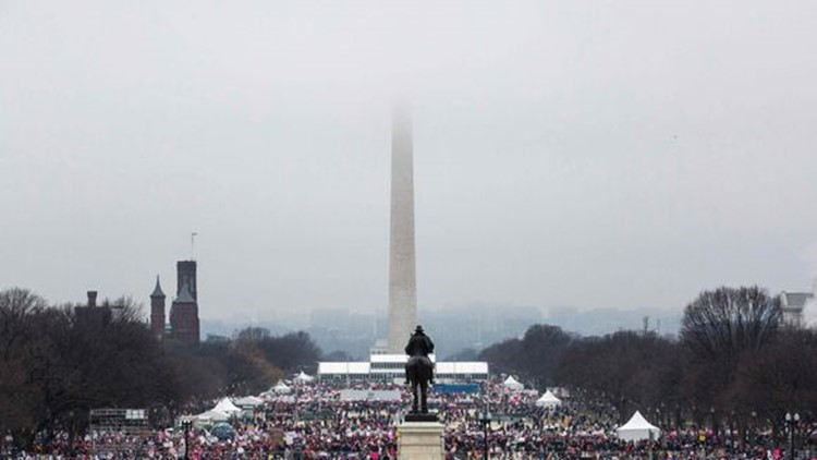 Protesters crowd the National Mall in Washington, D.C., during the Women's March on January 21, 2017. (Photo: Zach Gibson, AFB/Getty Images)
