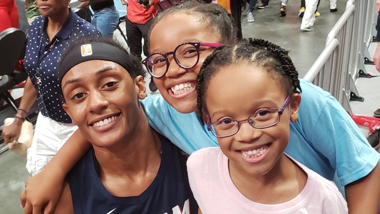 Mya Nelson, Brittney Sykes and Maci Nelson at ATL Dream game
