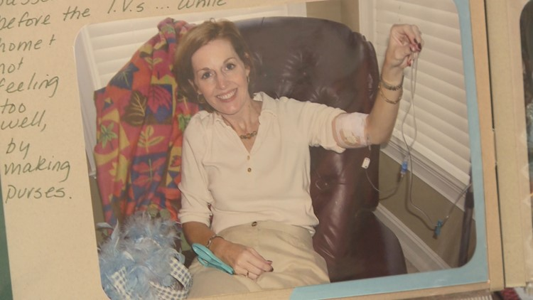 A smiling Kelly shows an IV coming out of her arm. It's one of the few signs to an outsider that hint at a life filled with a struggle, a constant battle to be well.