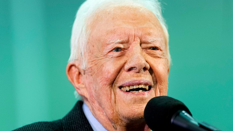 Vaccinated for virus, President Jimmy Carter and wife back in church