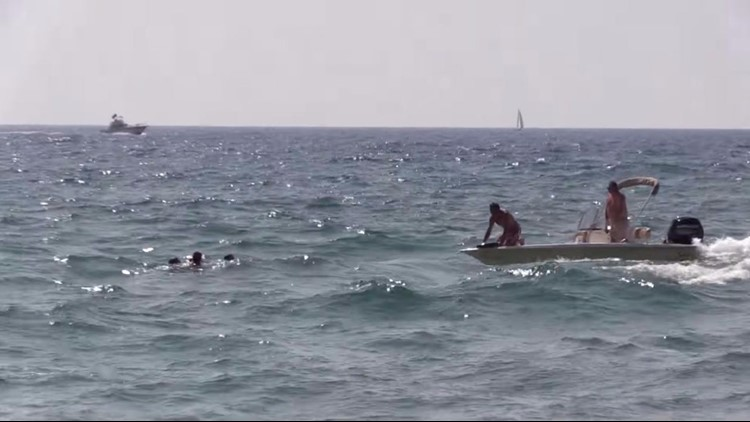 Watch: Boy, stepfather rescued from Lake Michigan rip current