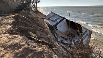 House falls off bluff to Lake Michigan shore